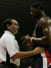 Mike Krzyzewski, left, shown here coaching LeBron James