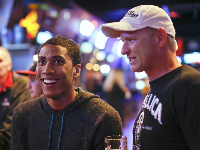Former C.M. Russell and Stanford basketball player, Josh Huestis, left, and Rob Skawinski watch the NBA Draft at the Sting Sports Bar Thursday.