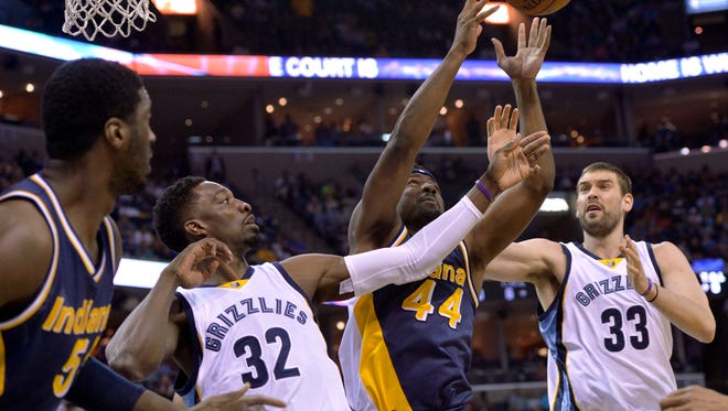 Indiana Pacers center Roy Hibbert (55), Memphis Grizzlies forward Jeff Green (32), Pacers forward Solomon Hill (4), and Grizzlies center Marc Gasol battle for the ball in the first half of an NBA basketball game Wednesday, April 15, 2015, in Memphis, Tenn. (AP Photo/Brandon Dill)