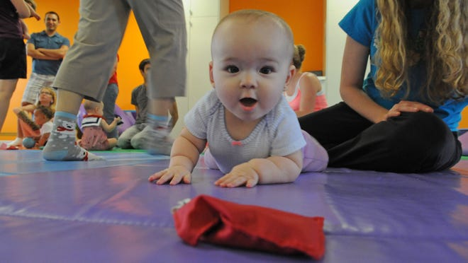 Isabella can't wait to get her hands on a red beanbag during a class at Gymboree in Melbourne.