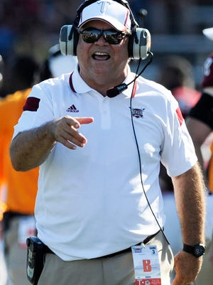 Troy University head coach Larry Blakeney instructs his players against New Mexico State at Veterans Memorial Stadium in Troy, Ala. on Saturday October 11, 2014. Blakeney has announced that he is retiring after the current season.