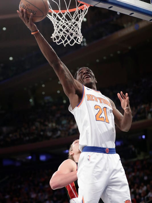 New York Knicks' Damyean Dotson (21) drives past Miami Heat's Kelly Olynyk during the second half of an NBA basketball game Friday, April 6, 2018, in New York. The Knicks won 122-98. (AP Photo/Frank Franklin II)
