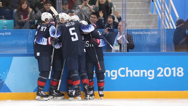Team USA celebrates a goal by Ryan Donato in the second period against Slovakia.
