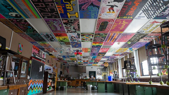 Painted ceiling tiles cover the walls of an empty art classroom at Topeka High School.