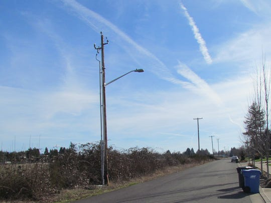 Moving 10 power poles is essential to the task of widening Kindle Way in Stayton.