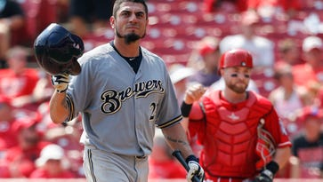 The Brewers' Matt Garza reacts after striking out against Reds starting pitcher John Lamb during a Sept. 5 game.