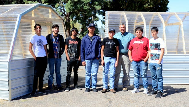 George Wertz, Construction Trades teacher at Deming High School, is surrounded by some of the students who build greenhouses in his class. The students are, from left: Daniel Martinez, Kevin Villescas, Enrique Santos, Ivan Lopez, Diego Mireles, Jose Nevarez and Ruben Aguilar.
