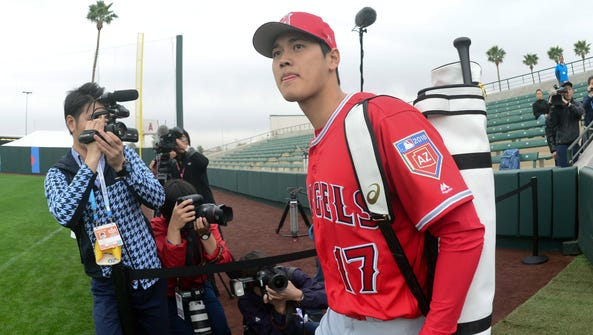 Glove - and bat - in tow, Shohei Ohtani was under the