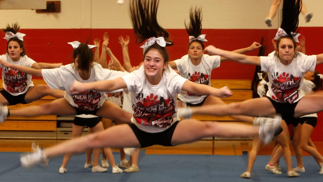 Julia Garrison, 16, a junior on the North Rockland cheerleading team, practices Dec. 18 at James A. Farley Elementary School in Stony Point. The team is going to NCA nationals in Dallas in January.