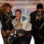 Coldplay singer Chris Martin performs with Beyoncé and Bruno Mars during halftime of the NFL Super Bowl 50 football game Sunday, Feb. 7, 2016, in Santa Clara, Calif. (AP Photo/Charlie Riedel)