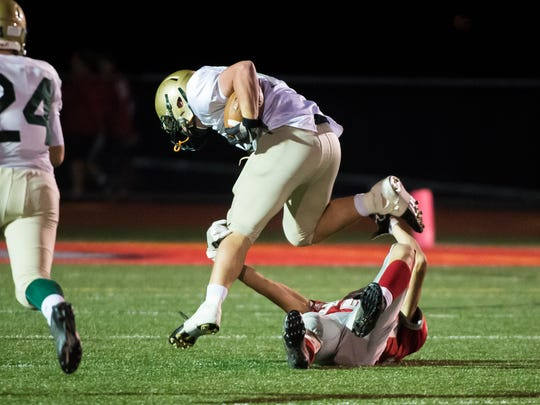 York Catholic's Jarred Kohl runs the ball into the endzone to score a touchdown after stripping the ball from Bermudian Springs' Thomas Bross on Friday, Oct. 20, 2017. York Catholic won 41-26.