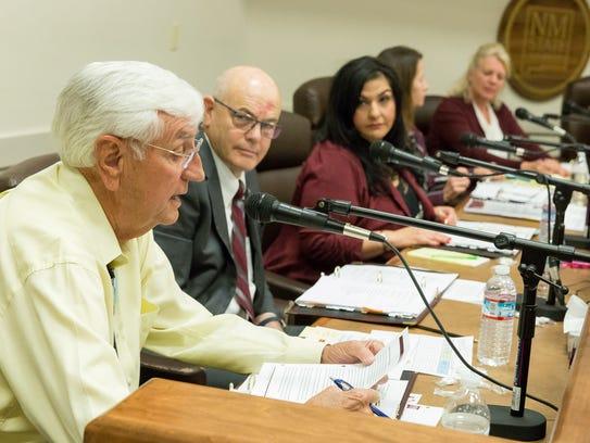 NMSU President Garrey Carruthers speaks during a Board