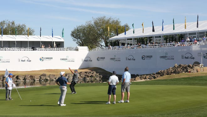 Fans enjoy the view from the Vons Pavilion, right, at PGA West in La Quinta during the Careerbuilder Challenge, January 17, 2018