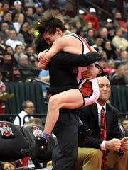 LsSalle's Lucas Byrd makes the leap for joy into te arms of  his brother after capturing the 113lb class state title at the OHSAA Division 1 State Individual Wrestling Championship, March 10, 2018.