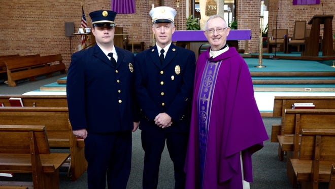 On behalf of the Immaculate Conception parish, Msgr. Seamus F. Brennan, far right, thanked the Somerville Fire Department and Rescue Squad during a recent Mass. He commended their prompt action when the parish made the 911 call last April following a fire in the church. Also pictured 1st Lt. Brian Ceponis, left, and Capt. Robert Lynn Jr. of the Central Hook and Ladder No. 1.