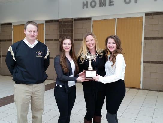 From left, Bradford Lusk, Fowlerville Principal; Kelsey