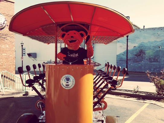 """""""Brewser"""" the bear is the Trolley Bike's official mascot."""