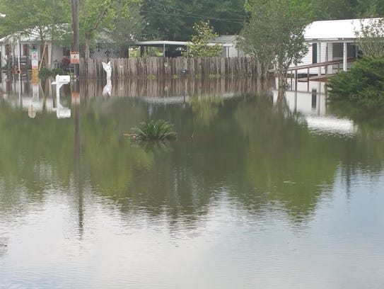 Flood waters surround homes in Cankton Monday after