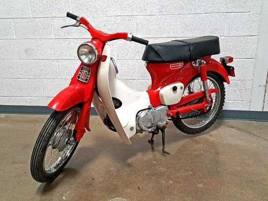 This 1966 (Honda 90) Cub CM91 motorcycle sold at auction