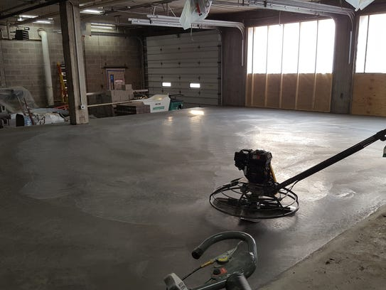 On Thursday, crews poured new concrete in the former