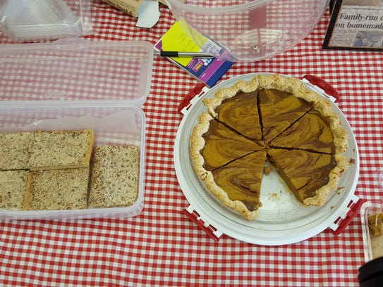 A sweet potato pie and some other treats sit out for