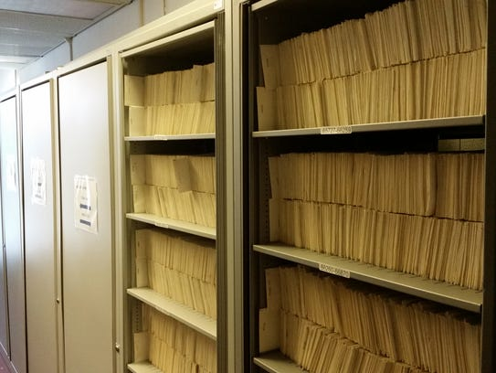 Cabinets containing adoption records, which have been