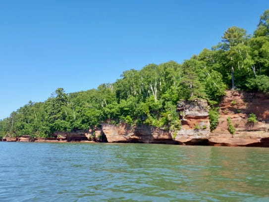 The mainland sea caves are accessible by kayak in the
