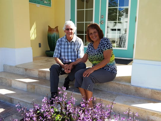 Mike and Marietta Cox sit on the front steps of their
