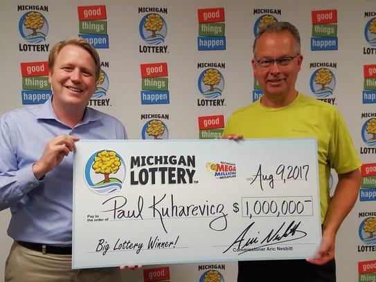 Michigan Lottery Commissioner, Aric Nesbitt, left,