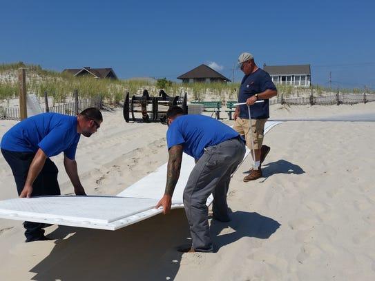 A longer beach mat for disabled beach access is installed
