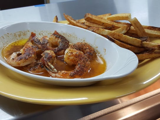 The broiled shrimp at Doe's Eat Place are blackened