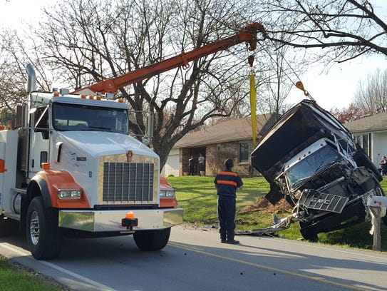 A dump truck rolled into a ditch Thursday evening.