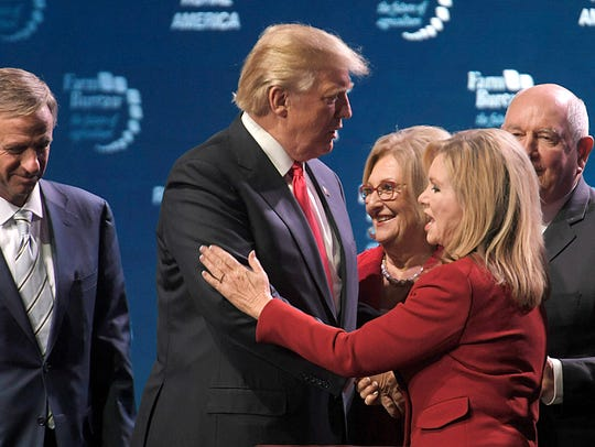 President Donald Trump shares the stage with Rep. Marsha Blackburn and other Republican leaders at Gaylord Opryland Resort & Convention Center on Jan. 8, 2018, in Nashville.