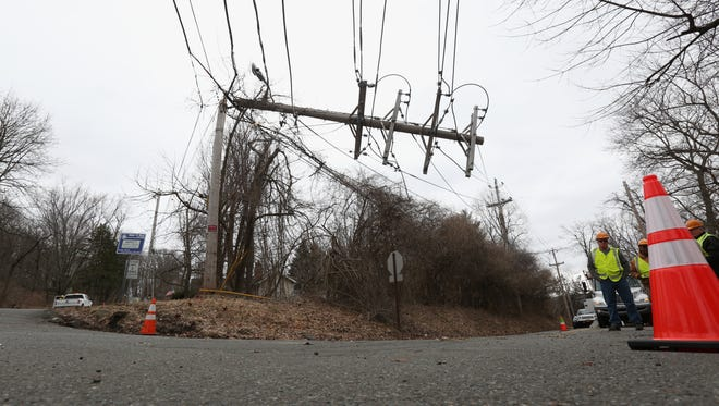 An Orange and Rockland crew repairs power lines on Storms Rd. in Valley Cottage March 5, 2018. Power has been out in the neighborhood since March 2.