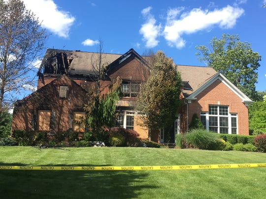 The aftermath of the house fire on Oak Lane Road in Green Brook.