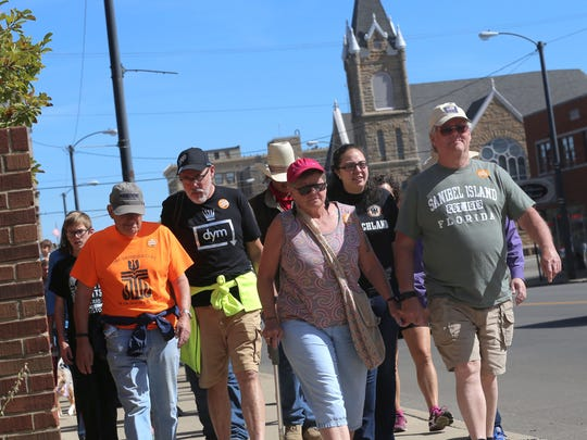 Participants of the Church World Service CROP Hunger Walk march down Park Avenue in Mansfield on Sunday afternoon. Twenty-five percent of the money raised from the event will be given to local food pantries at Grace Episcopal Church and Mosaic.
