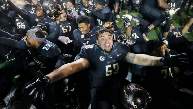 Vanderbilt offensive lineman Sean Auwae-McMoore (53) celebrates with teammates after beating Tennessee on Nov. 26, 2016.