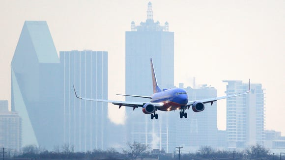 A Southwest Airlines jet lands at Love Field in Dallas