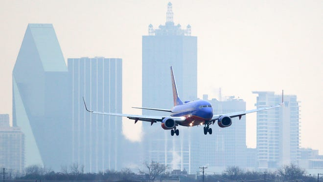 A Southwest Airlines jet lands at Love Field in Dallas on Feb. 3, 2014.