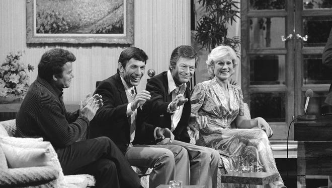Cast members of Star Trek II : The Wrath of  Khan get together for a special salute on The MERV Show in 1982 in Los Angeles. Members of the USS Enterprise, from left, are William Shatner, Leonard Nimoy, DeForest Kelley and Bibi Besch.