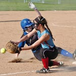 Oconto's Brooke Kollman slides safely into third base, beating a throw to Southern Door's Gabby Atkins in a game Thursday.
