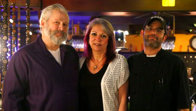 The general manager of the Falcon Room Supper Club & Lounge Dave Rhinehart (left) stands with the owner Shelli Street (center) and chef Bradley Pearce. The restaurant is at 777 Lexington Ave. in Mansfield.
