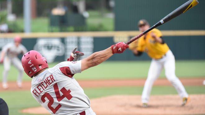 Razorback sophomore center fielder Dominic Fletcher slaps a double to the gap against Southern Miss in the winner's bracket game of the Fayetteville Regional NCAA Baseball Tournament Saturday in Fayetteville.