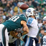Philadelphia Eagles outside linebacker Connor Barwin (98) knocks ball loose from Titans quarterback Zach Mettenberger (7) in the Titans loss last week. The Titans have had some bad seasons, but 2014 is shaping up as the worst.