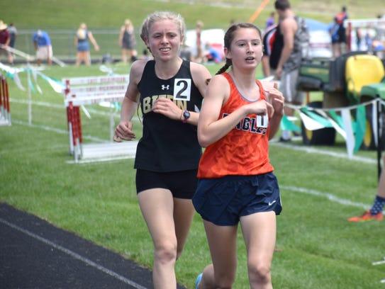Buffalo Gap's Annika Fisher, left, stays with Clarke