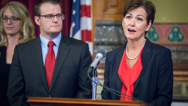 Iowa Gov. Kim Reynolds introduces her acting Lt. Gov. Adam Gregg Thursday, May 25, 2017, at the Governor's formal office in the Statehouse.