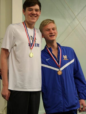 Hudson Pace (left) and Whit Lawrence placed first and third, respectively, in the 100 freestyle on Friday at the 7A/6A-West Conference meet at Bentonville.