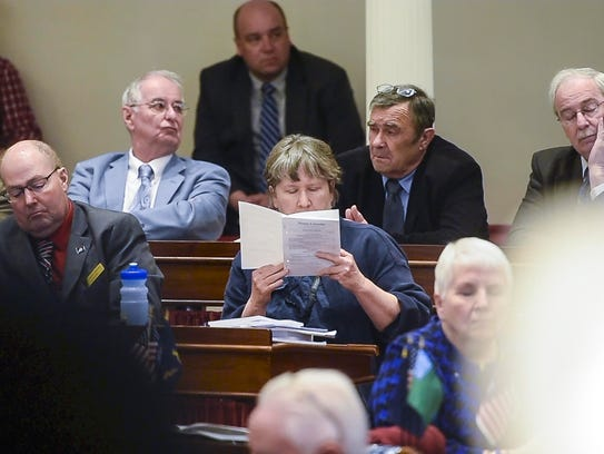Rep. Cynthia Browning, D-Arlington, center, and other