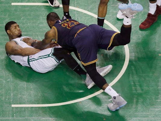 Cleveland Cavaliers forward LeBron James (23) falls to the floor with Boston Celtics guard Marcus Smart during the second quarter of Game 1 of the NBA basketball Eastern Conference finals, Wednesday, May 17, 2017, in Boston. (AP Photo/Charles Krupa)