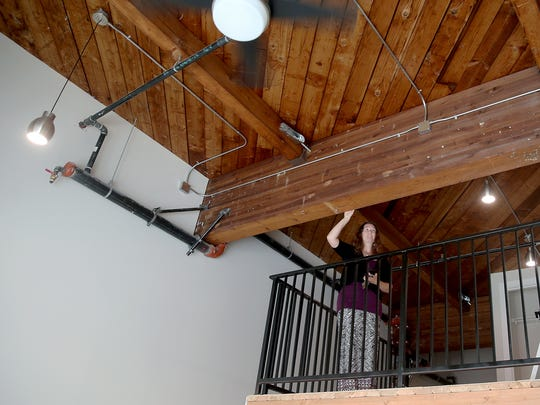 Marianne Weber, a property manager for the Sound West Group in the loft at one of the apartments, at the B Flats Apartments on Fourth Street in Bremerton. The loft apartments have the original fir wood beams.